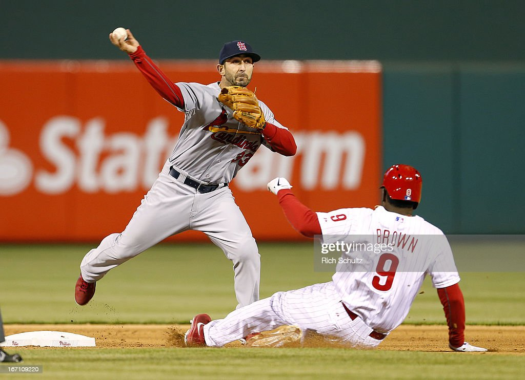 Second baseman <a gi-track='captionPersonalityLinkClicked' href=/galleries/search?phrase=Daniel+Descalso&family=editorial&specificpeople=6800752 ng-click='$event.stopPropagation()'>Daniel Descalso</a> #33 of the St. Louis Cardinals gets Domonic Brown #9 of the Philadelphia Phillies at second and throws to first to get John Mayberry #15 for an inning ending double play in the seventh inning in a MLB baseball game on April 20, 2013 at Citizens Bank Park in Philadelphia, Pennsylvania. The Cardinals defeated the Phillies 5-0.