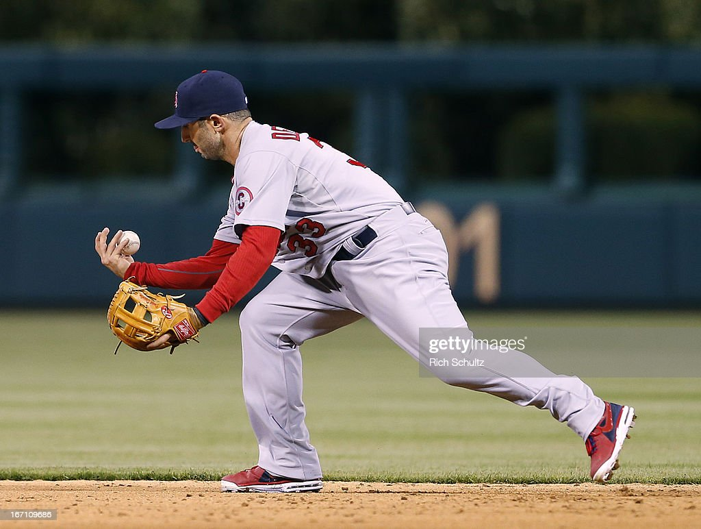 Second baseman <a gi-track='captionPersonalityLinkClicked' href=/galleries/search?phrase=Daniel+Descalso&family=editorial&specificpeople=6800752 ng-click='$event.stopPropagation()'>Daniel Descalso</a> #33 of the St. Louis Cardinals makes an error as he bobbles a ball hit by Freddy Galvis #13 of the Philadelphia Phillies in the ninth inning in a MLB baseball game on April 20, 2013 at Citizens Bank Park in Philadelphia, Pennsylvania. The Cardinals defeated the Phillies 5-0.