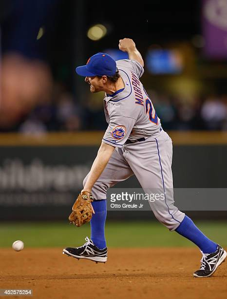 Second baseman Daniel Murphy of the New York Mets can't get to an infield single off the bat of Robinson Cano of the Seattle Mariners in the ninth...