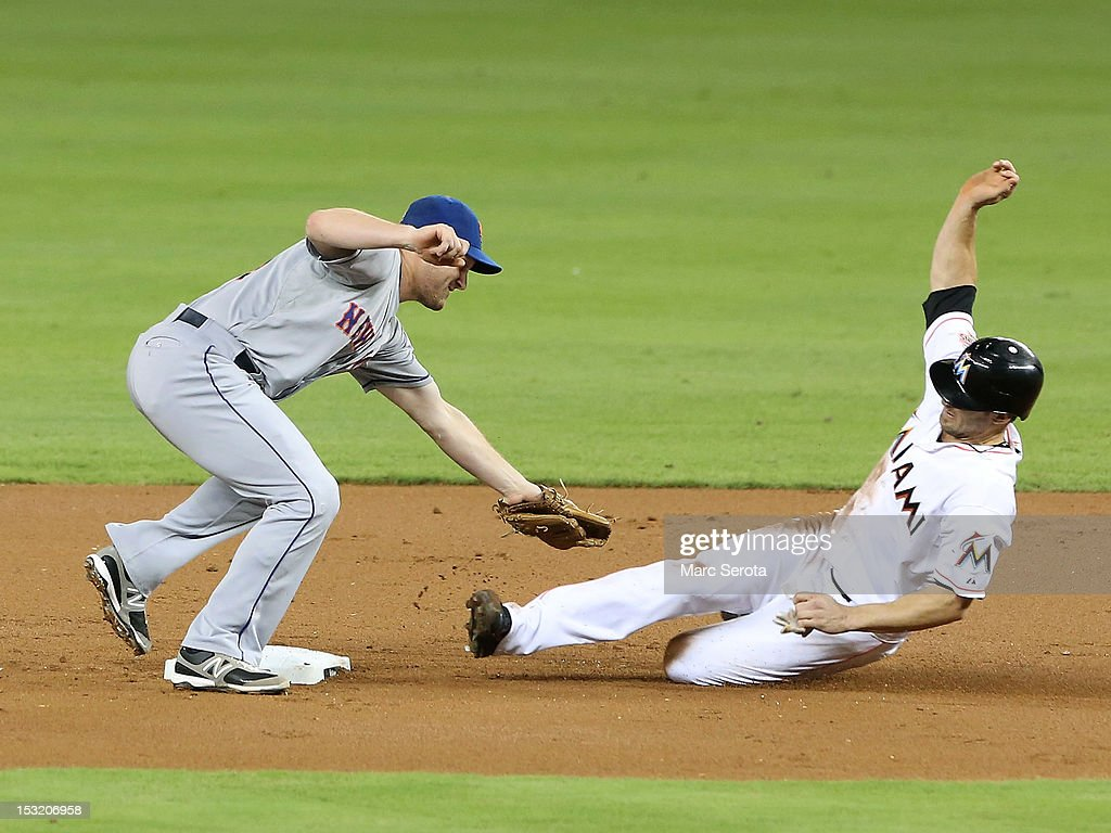 Second baseman Daniel Murphy #28 of the New York Mets catches Gorkys Hernandez #2 of the Miami Marlins stealing at Marlins Park on October 1, 2012 in Miami, Florida.