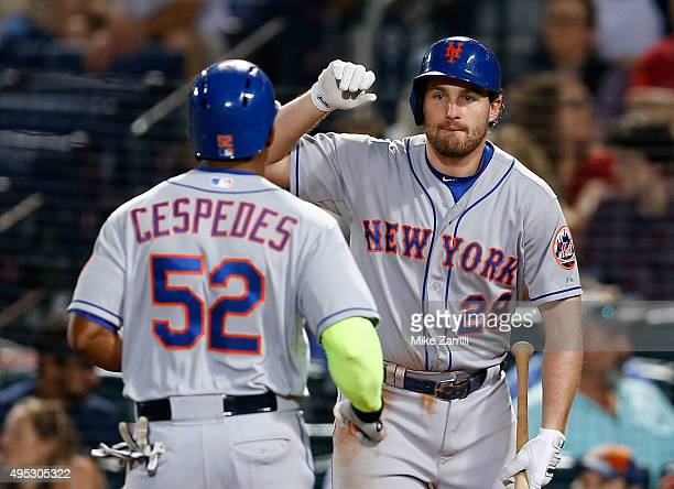 Second baseman Daniel Murphy of the New York Mets congratulates outfielder Yoenis Cespedes after Cespedes' home run during the game against the...
