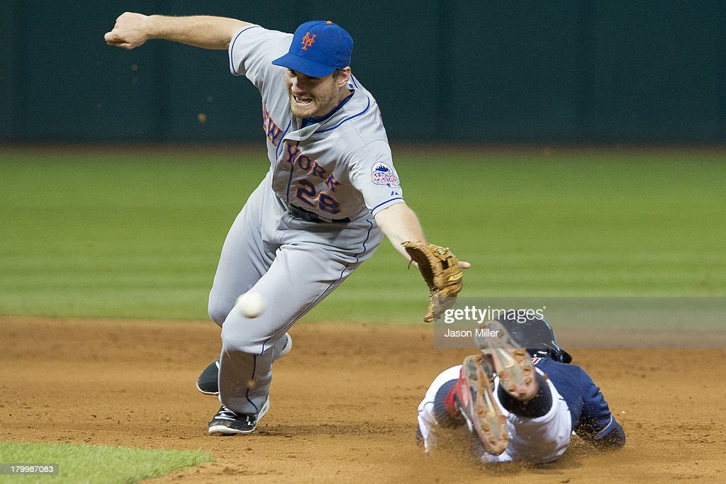 Second baseman Daniel Murphy #28 of the New York Mets dives at a wild throw as <a gi-track='captionPersonalityLinkClicked' href=/galleries/search?phrase=Jason+Kipnis&family=editorial&specificpeople=5330784 ng-click='$event.stopPropagation()'>Jason Kipnis</a> #22 of the Cleveland Indians steals second during the sixth inning at Progressive Field on September 7, 2013 in Cleveland, Ohio.