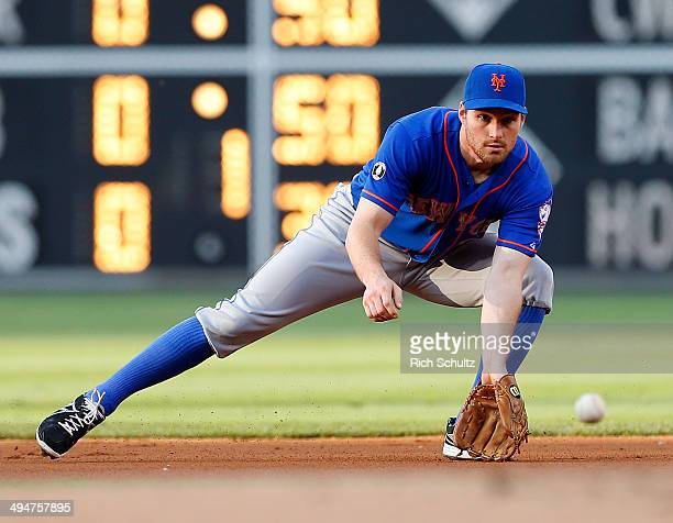Second baseman Daniel Murphy of the New York Mets fields a ground ball hit by Ben Revere of the Philadelphia Phillies during the first inning in a...