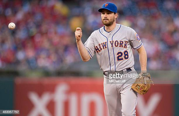Second baseman Daniel Murphy of the New York Mets flips the ball to first base to complete a double play in the bottom of the second inning against...