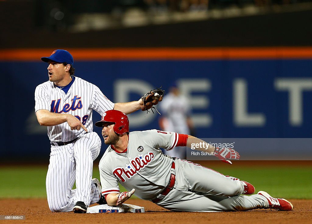Second baseman Daniel Murphy of the New York Mets gets Darin Ruf of the Philadelphia Phillies who attempted to stretch an RBI single into a double...