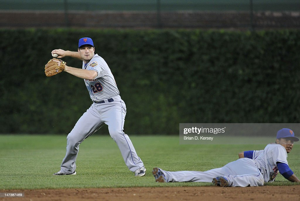 Second baseman Daniel Murphy #28 of the New York Mets (L) gets ready to throw the ball as shortstop Ruben Tejada #11 watches against the Chicago Cubs at Wrigley Field on June 26, 2012 in Chicago, Illinois. The Cubs defeated the Mets 5-3.