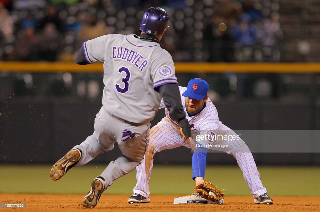Second baseman Daniel Murphy #28 of the New York Mets prepares to tag out Michael Cuddyer #3 of the Colorado Rockies as he attempts to steal second base at Coors Field on April 16, 2013 in Denver, Colorado.
