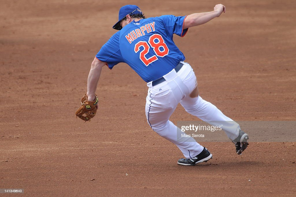 Second baseman Daniel Murphy #28 of the New York Mets throws against the St. Louis Cardinals at Digital Domain Park on March 13, 2012 in Port St. Lucie, Florida.