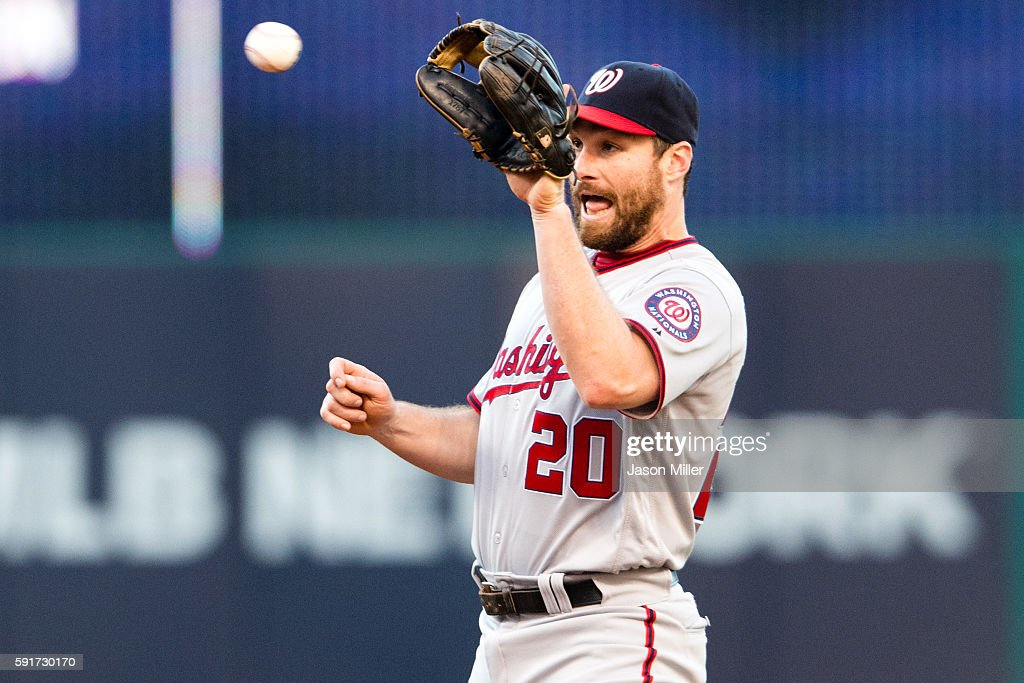 Second baseman Daniel Murphy of the Washington Nationals catches a line drive hit by Roberto Perez of the Cleveland Indians to end the second inning...