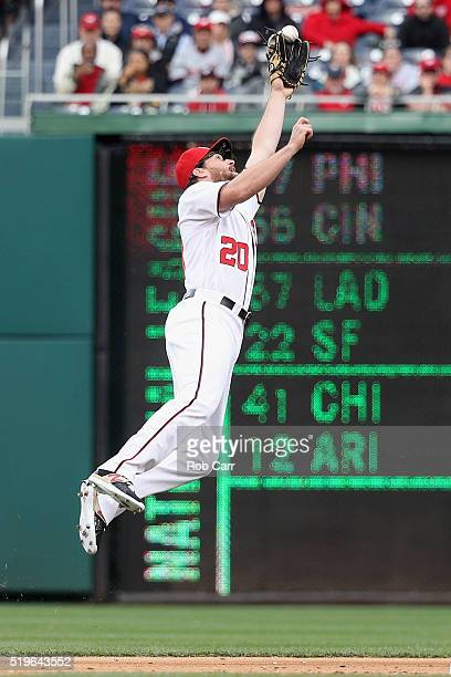 Second baseman Daniel Murphy of the Washington Nationals misses a RBI single hit by JT Realmuto of the Miami Marlins in the first inning of the...