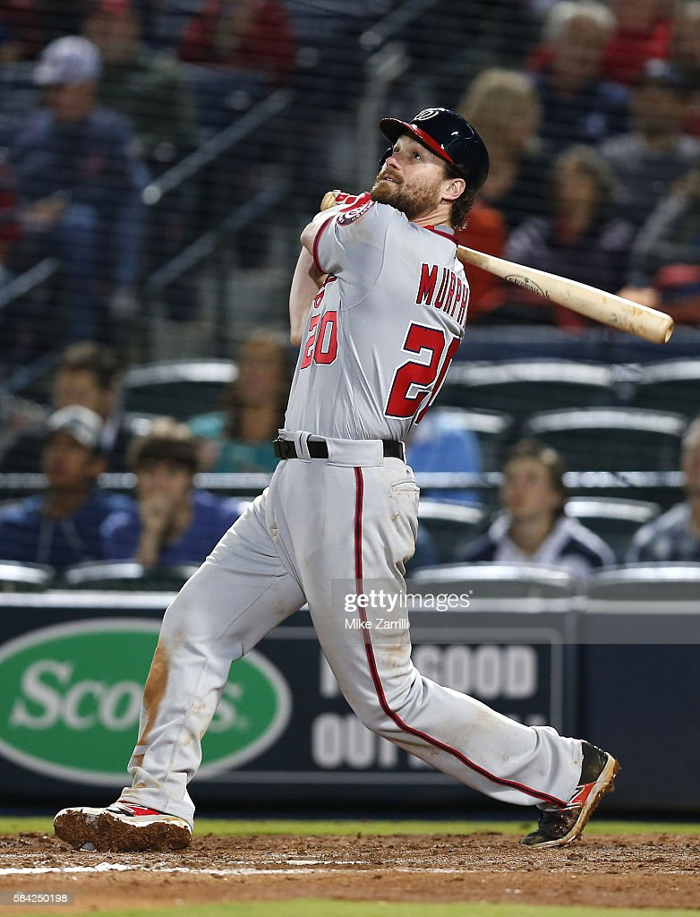 Second baseman Daniel Murphy of the Washington Nationals swings during the game against the Atlanta Braves at Turner Field on April 6 2016 in Atlanta...
