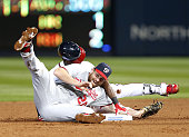 Second baseman Daniel Murphy of the Washington Nationals tags out third baseman Adonis Garcia of the Atlanta Braves in the fourth inning during the...