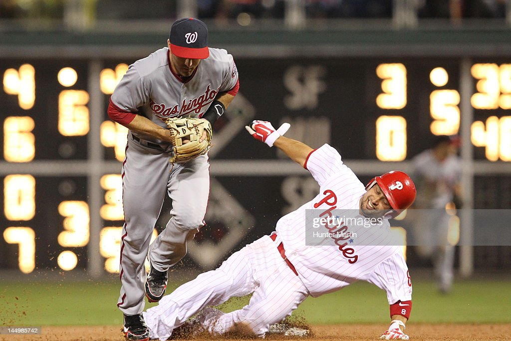Second baseman <a gi-track='captionPersonalityLinkClicked' href=/galleries/search?phrase=Danny+Espinosa&family=editorial&specificpeople=4410764 ng-click='$event.stopPropagation()'>Danny Espinosa</a> #8 of the Washington Nationals catches a force out as center fielder <a gi-track='captionPersonalityLinkClicked' href=/galleries/search?phrase=Shane+Victorino&family=editorial&specificpeople=576251 ng-click='$event.stopPropagation()'>Shane Victorino</a> #8 of the Philadelphia Phillies slides into second base during a game at Citizens Bank Park on May 21, 2012 in Philadelphia, Pennsylvania. The Nationals won 2-1.