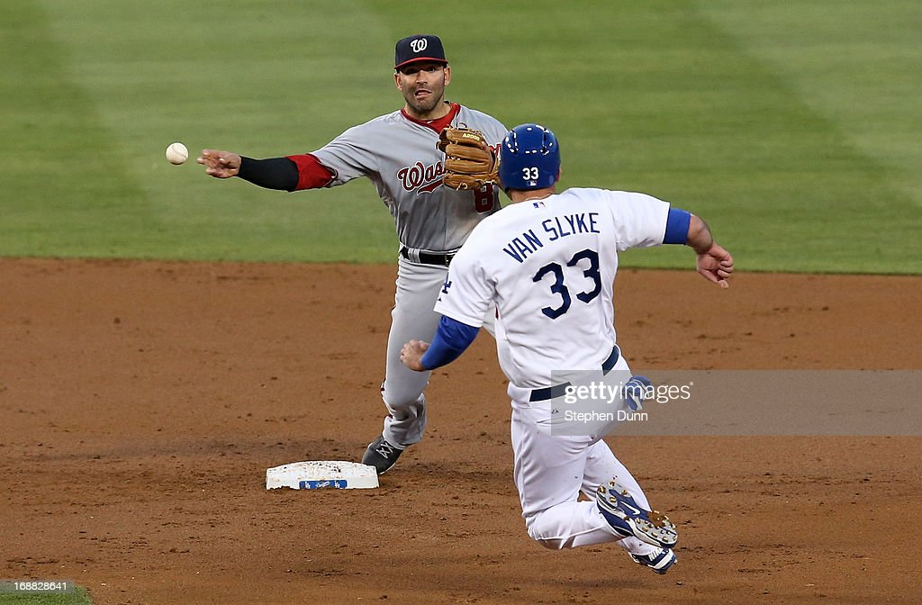 Second baseman <a gi-track='captionPersonalityLinkClicked' href=/galleries/search?phrase=Danny+Espinosa&family=editorial&specificpeople=4410764 ng-click='$event.stopPropagation()'>Danny Espinosa</a> #8 of the Washington Nationals throws to first to complete a double play after forcing out Scott Van Slyke #33 of the Los Angeles Dodgers in the second inning at Dodger Stadium on May 15, 2013 in Los Angeles, California.