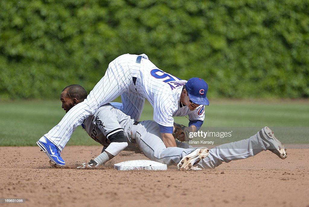 Second baseman <a gi-track='captionPersonalityLinkClicked' href=/galleries/search?phrase=Darwin+Barney&family=editorial&specificpeople=537975 ng-click='$event.stopPropagation()'>Darwin Barney</a> #15 of the Chicago Cubs falls on <a gi-track='captionPersonalityLinkClicked' href=/galleries/search?phrase=Alexei+Ramirez&family=editorial&specificpeople=690568 ng-click='$event.stopPropagation()'>Alexei Ramirez</a> #10 of the Chicago White Sox after Ramirez stole second base during the fifth inning at Wrigley Field on May 29, 2013 in Chicago, Illinois.