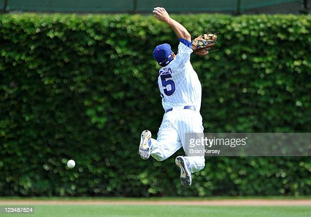 Second baseman Darwin Barney of the Chicago Cubs jumps for but cannot catch a single hit by Derrek Lee of the Pittsburgh Pirates during the fourth...
