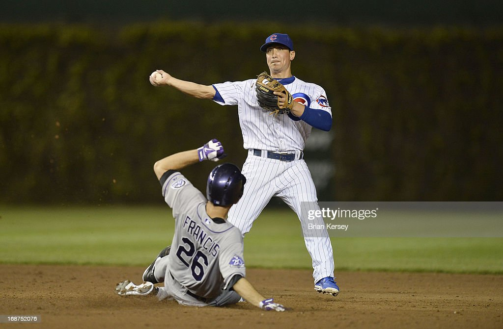 Second baseman <a gi-track='captionPersonalityLinkClicked' href=/galleries/search?phrase=Darwin+Barney&family=editorial&specificpeople=537975 ng-click='$event.stopPropagation()'>Darwin Barney</a> #15 of the Chicago Cubs throws to first base after forcing out <a gi-track='captionPersonalityLinkClicked' href=/galleries/search?phrase=Jeff+Francis&family=editorial&specificpeople=220827 ng-click='$event.stopPropagation()'>Jeff Francis</a> #26 of the Colorado Rockies on a ground ball hit by Eric Young Jr. (not pictured) during the sixth inning on May 14, 2013 at Wrigley Field in Chicago, Illinois. Young was safe at first.