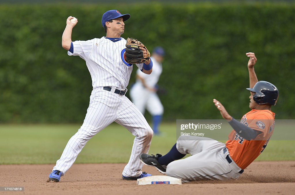 Second baseman Darwin Barney #15 of the Chicago Cubs turns a double play on a ground ball hit by Matt Dominguez (not pictured) of the Houston Astros as Justin Maxwell #44 slides into second base during the seventh inning at Wrigley Field on June 21, 2013 in Chicago, Illinois.
