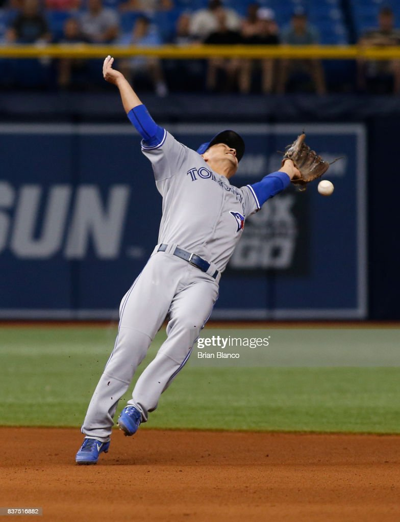 Second baseman Darwin Barney #18 of the Toronto Blue Jays makes an attempt on the single by Wilson Ramos of the Tampa Bay Rays during the seventh inning of a game on August 22, 2017 at Tropicana Field in St. Petersburg, Florida.