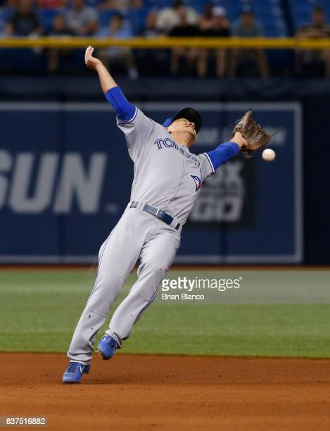 Second baseman Darwin Barney of the Toronto Blue Jays makes an attempt on the single by Wilson Ramos of the Tampa Bay Rays during the seventh inning...