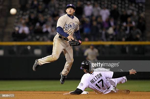 Second baseman David Eckstein of the San Diego Padres turns a double play on Todd Helton of the Colorado Rockies on a grounder by Troy Tulowitzki to...