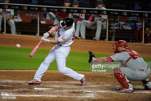 Second Baseman Derek Dietrich of the Miami Marlins hits a double off of Aaron Nola during the 4th inning of the game between the Philadelphia...
