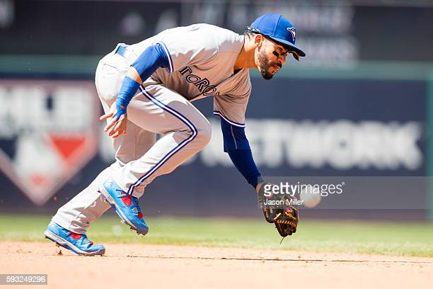 Second baseman Devon Travis of the Toronto Blue Jays can't get to a ground ball hit by Jason Kipnis of the Cleveland Indians during the sixth inning...