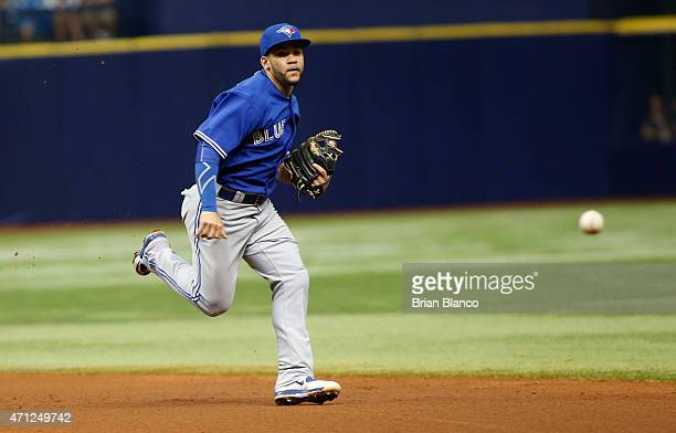 Second baseman Devon Travis of the Toronto Blue Jays chases down the single by Rene Rivera of the Tampa Bay Rays during the fourth inning of a game...
