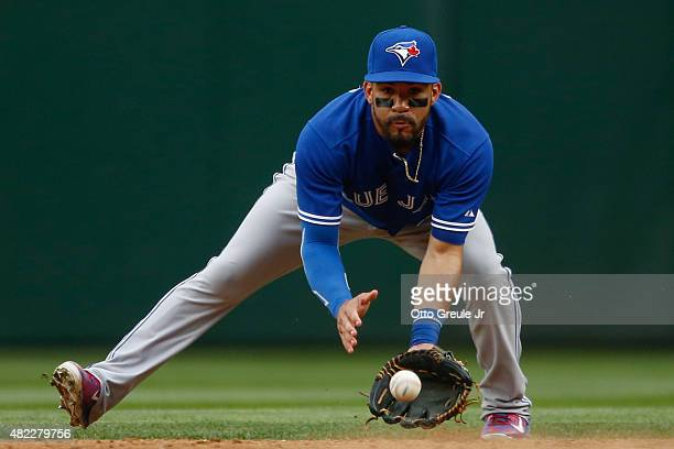 Second baseman Devon Travis of the Toronto Blue Jays fields a ground ball against the Seattle Mariners at Safeco Field on July 25 2015 in Seattle...