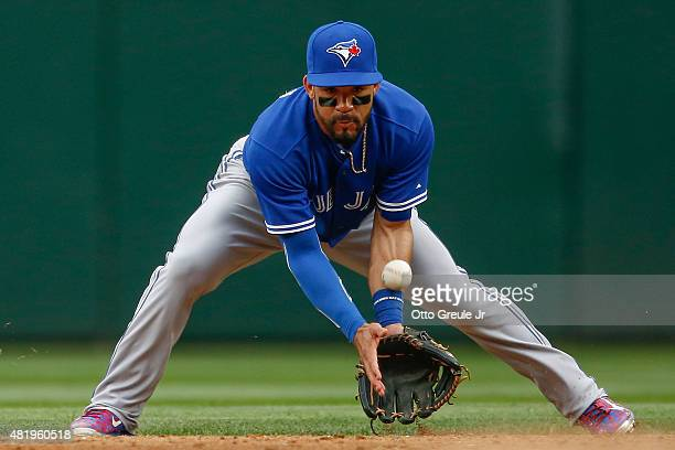 Second baseman Devon Travis of the Toronto Blue Jays misplays a grounder off the bat of Robinson Cano of the Seattle Mariners in the third inning at...