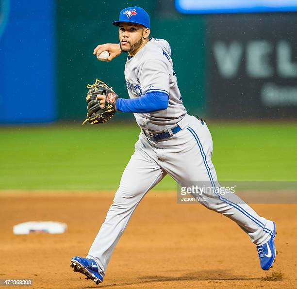 Second baseman Devon Travis of the Toronto Blue Jays throws out Michael Brantley of the Cleveland Indians during the third inning at Progressive...