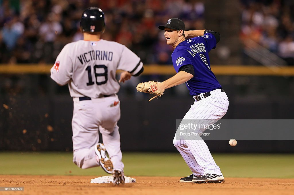 Second baseman <a gi-track='captionPersonalityLinkClicked' href=/galleries/search?phrase=DJ+LeMahieu&family=editorial&specificpeople=5940806 ng-click='$event.stopPropagation()'>DJ LeMahieu</a> #9 of the Colorado Rockies drops the ball after getting a force on <a gi-track='captionPersonalityLinkClicked' href=/galleries/search?phrase=Shane+Victorino&family=editorial&specificpeople=576251 ng-click='$event.stopPropagation()'>Shane Victorino</a> #18 of the Boston Red Sox but was unable to complete the double play on Daniel Nava #29 of the Boston Red Sox in the eighth inning at Coors Field on September 24, 2013 in Denver, Colorado.