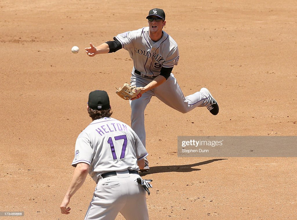 Second baseman <a gi-track='captionPersonalityLinkClicked' href=/galleries/search?phrase=DJ+LeMahieu&family=editorial&specificpeople=5940806 ng-click='$event.stopPropagation()'>DJ LeMahieu</a> #9 of the Colorado Rockies flips the ball to first baseman <a gi-track='captionPersonalityLinkClicked' href=/galleries/search?phrase=Todd+Helton&family=editorial&specificpeople=200735 ng-click='$event.stopPropagation()'>Todd Helton</a> #17 but is too late to get Skcip Schumaker #55 of the Los Angeles Dodgers in the first inning at Dodger Stadium on July 14, 2013 in Los Angeles, California.