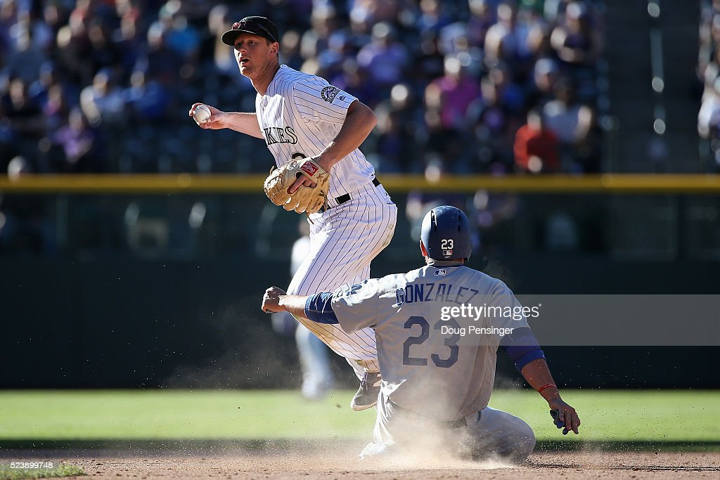 Second baseman DJ LeMahieu of the Colorado Rockies gets a force out on Adrian Gonzalez of the Los Angeles Dodgers on a ground ball by Yasmani Grandal...
