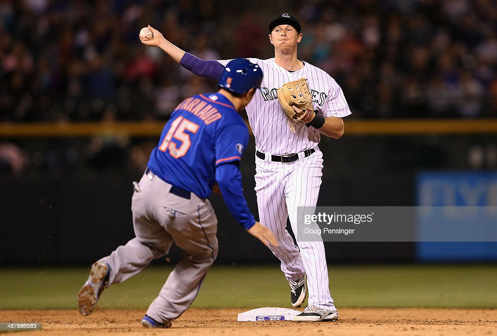 Second baseman <a gi-track='captionPersonalityLinkClicked' href=/galleries/search?phrase=DJ+LeMahieu&family=editorial&specificpeople=5940806 ng-click='$event.stopPropagation()'>DJ LeMahieu</a> #9 of the Colorado Rockies turns a double play on Travis d'Arnaud #15 of the New York Mets on a ground ball by Ruben Tejada #11 of the New York Mets in the sixth inning at Coors Field on May 2, 2014 in Denver, Colorado.