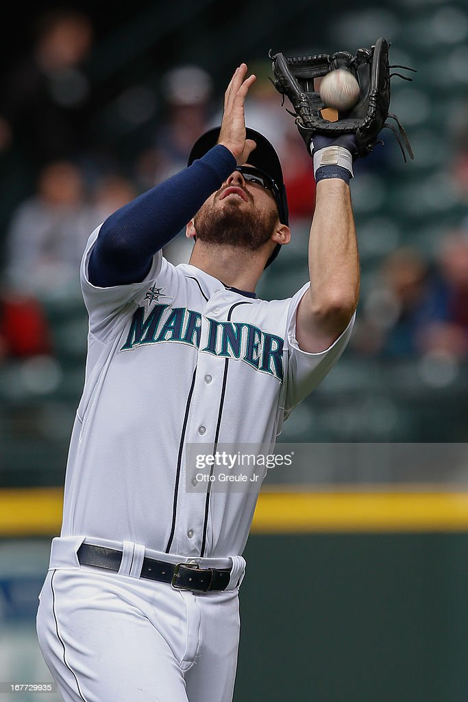 Second baseman <a gi-track='captionPersonalityLinkClicked' href=/galleries/search?phrase=Dustin+Ackley&family=editorial&specificpeople=4352278 ng-click='$event.stopPropagation()'>Dustin Ackley</a> #13 of the Seattle Mariners catches a pop fly ball hit by Mark Trumbo of the Los Angeles Angels of Anaheim in the seventh inning at Safeco Field on April 28, 2013 in Seattle, Washington. The Mariners defeated the Angels 2-1.