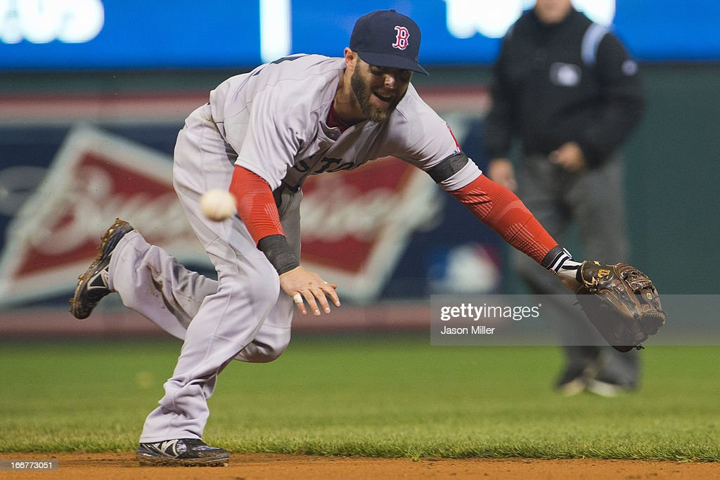 Second baseman <a gi-track='captionPersonalityLinkClicked' href=/galleries/search?phrase=Dustin+Pedroia&family=editorial&specificpeople=836339 ng-click='$event.stopPropagation()'>Dustin Pedroia</a> of the Boston Red Sox can't get to a ground ball hit by Michael Brantley of the Cleveland Indians for a single during the sixth inning at Progressive Field on April 16, 2013 in Cleveland, Ohio. All uniformed team members are wearing jersey number 42 in honor of Jackie Robinson Day.