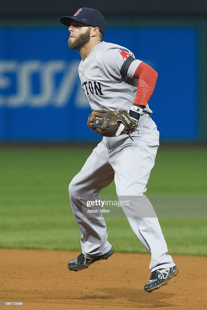 Second baseman <a gi-track='captionPersonalityLinkClicked' href=/galleries/search?phrase=Dustin+Pedroia&family=editorial&specificpeople=836339 ng-click='$event.stopPropagation()'>Dustin Pedroia</a> of the Boston Red Sox waits for a play while sporing a black arm band in recognition of the events in Boston during the fourth inning against the Cleveland Indians at Progressive Field on April 16, 2013 in Cleveland, Ohio. All uniformed team members are wearing jersey number 42 in honor of Jackie Robinson Day.