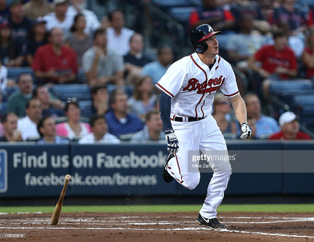 Second baseman <a gi-track='captionPersonalityLinkClicked' href=/galleries/search?phrase=Elliot+Johnson+-+Baseball+Player&family=editorial&specificpeople=4175454 ng-click='$event.stopPropagation()'>Elliot Johnson</a> #30 of the Atlanta Braves brakes out of the batter's box after connecting on a second inning triple during the game against the Cleveland Indians at Turner Field on August 27, 2013 in Atlanta, Georgia.