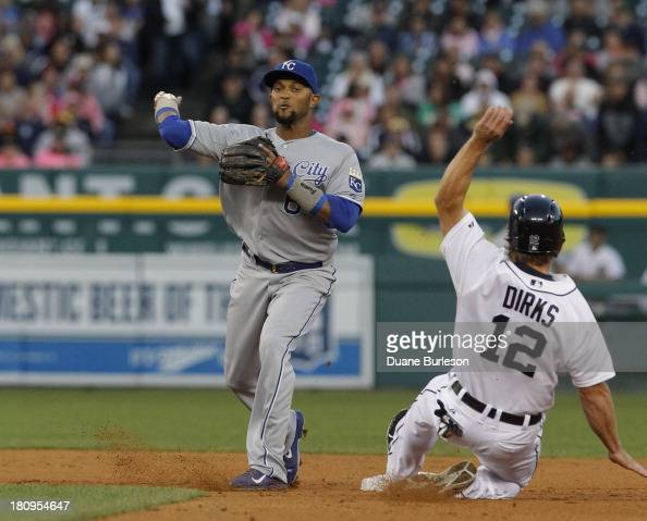 Second baseman Emilio Bonifacio of the Kansas City Royals turns the ball after getting a force out on Andy Dirks of the Detroit Tigers in the second...