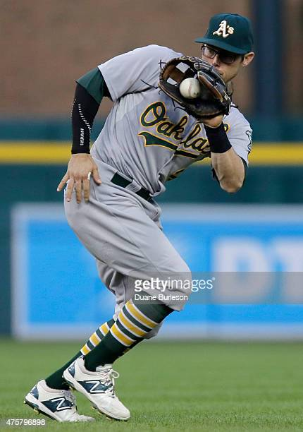 Second baseman Eric Sogard of the Oakland Athletics fields the grounder hit by Jose Iglesias of the Detroit Tigers and throws him out during the...