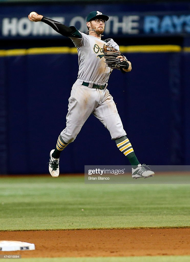 Second baseman <a gi-track='captionPersonalityLinkClicked' href=/galleries/search?phrase=Eric+Sogard&family=editorial&specificpeople=6796459 ng-click='$event.stopPropagation()'>Eric Sogard</a> #28 of the Oakland Athletics makes the throw to first base as he fields the ground out by James Loney #21 of the Tampa Bay Rays during the sixth inning of a game on May 21, 2015 at Tropicana Field in St. Petersburg, Florida.
