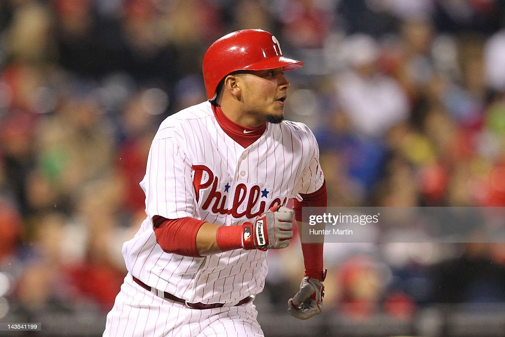 Second baseman Freddy Galvis #13 of the Philadelphia Phillies runs to first base during a game against the Chicago Cubs at Citizens Bank Park on April 28, 2012 in Philadelphia, Pennsylvania. The Phillies won 5-2.