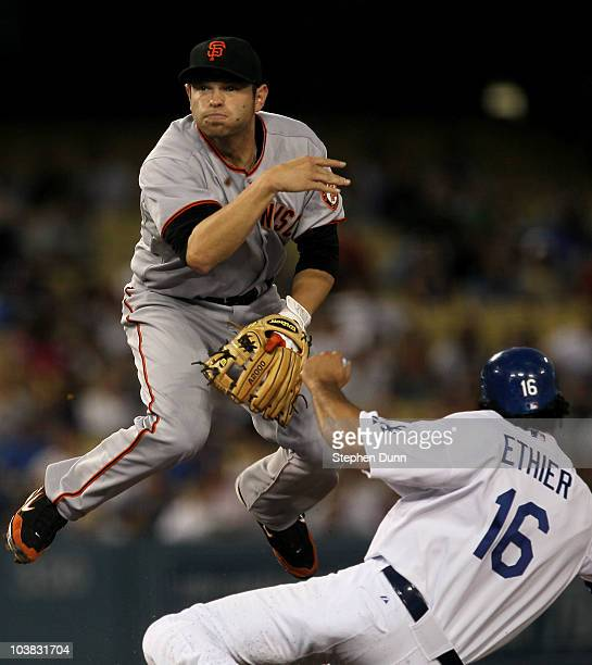 Second baseman Freddy Sanchez of the San Francisco Giants throws to first to complete a double play after forcing out Andre Ethier of the Los Angeles...