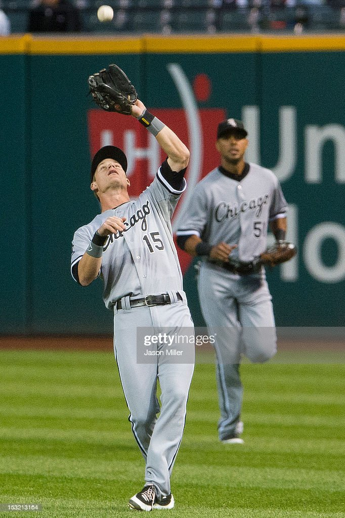 Second baseman <a gi-track='captionPersonalityLinkClicked' href=/galleries/search?phrase=Gordon+Beckham&family=editorial&specificpeople=5411079 ng-click='$event.stopPropagation()'>Gordon Beckham</a> #15 catches a pop fly with backup by right fielder <a gi-track='captionPersonalityLinkClicked' href=/galleries/search?phrase=Alex+Rios&family=editorial&specificpeople=224676 ng-click='$event.stopPropagation()'>Alex Rios</a> #51 of the Chicago White Sox during the first inning against the Cleveland Indians at Progressive Field on October 1, 2012 in Cleveland, Ohio.