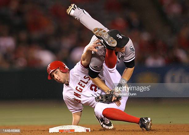 Second baseman Gordon Beckham of the Chicago White Sox and Peter Bourjos of the Los Angeles Angels of Anaheim collide as Beckham turns a double play...