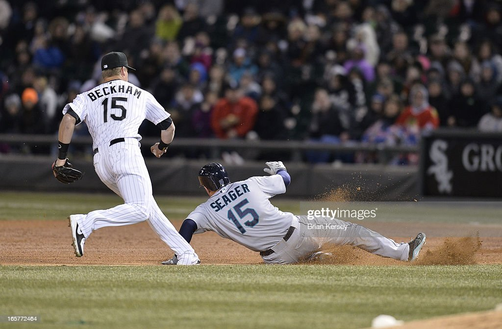 Second baseman Gordon Beckham #15 of the Chicago White Sox (L) tags out Kyle Seager #15 of the Seattle Mariners after Seager was picked off first base and caught in a run-down during the fourth inning on April 5, 2012 at U.S. Cellular Field in Chicago, Illinois.