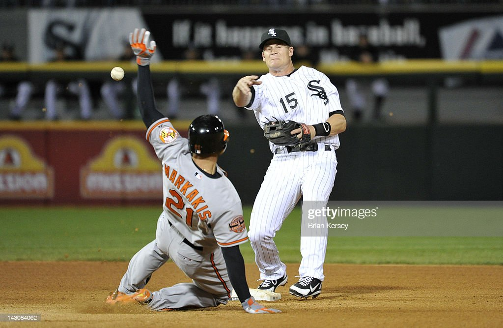 Second baseman Gordon Beckham of the Chicago White Sox throws to first base after forcing out Nick Markakis of the Baltimore Orioles on a ground ball...