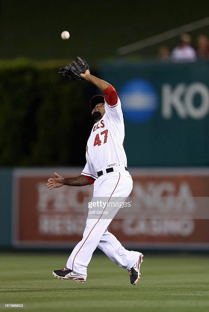 Second baseman <a gi-track='captionPersonalityLinkClicked' href=/galleries/search?phrase=Howie+Kendrick&family=editorial&specificpeople=628938 ng-click='$event.stopPropagation()'>Howie Kendrick</a> #47 of the Los Angeles Angels of Anaheim fields a pop fly by Matt Wieters (not pictured) of the Baltimore Orioles in the fifth inning at Angel Stadium of Anaheim on May 3, 2013 in Anaheim, California.