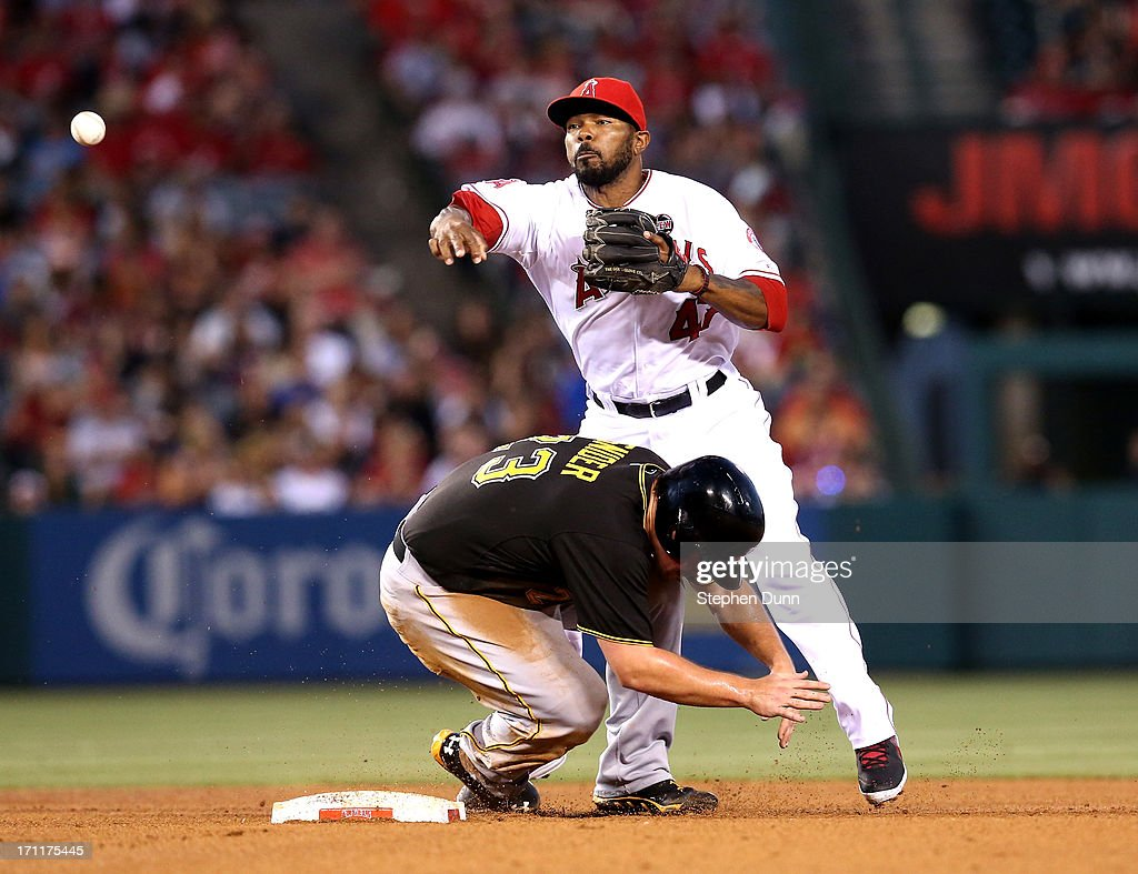 Second baseman <a gi-track='captionPersonalityLinkClicked' href=/galleries/search?phrase=Howie+Kendrick&family=editorial&specificpeople=628938 ng-click='$event.stopPropagation()'>Howie Kendrick</a> #47 of the Los Angeles Angels of Anaheim throws to first to turn a double play after forcing out <a gi-track='captionPersonalityLinkClicked' href=/galleries/search?phrase=Travis+Snider&family=editorial&specificpeople=4959427 ng-click='$event.stopPropagation()'>Travis Snider</a> #23 of the Pittsburgh Pirates in the fourth inning at Angel Stadium of Anaheim on June 22, 2013 in Anaheim, California.